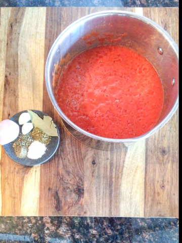 marinara sauce with spices in a saucepan