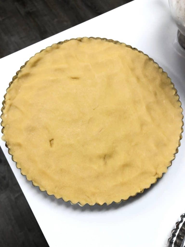 shortbread dough pressed into the tart pan