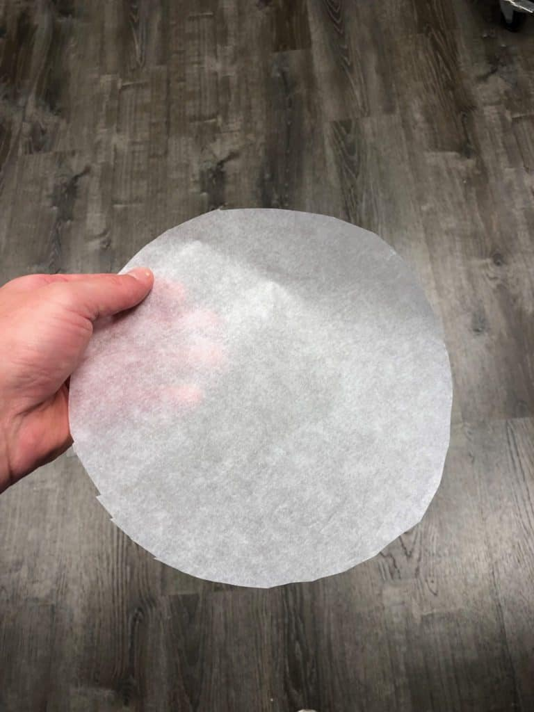 parchment paper cut into a circle to fit into a tart pan