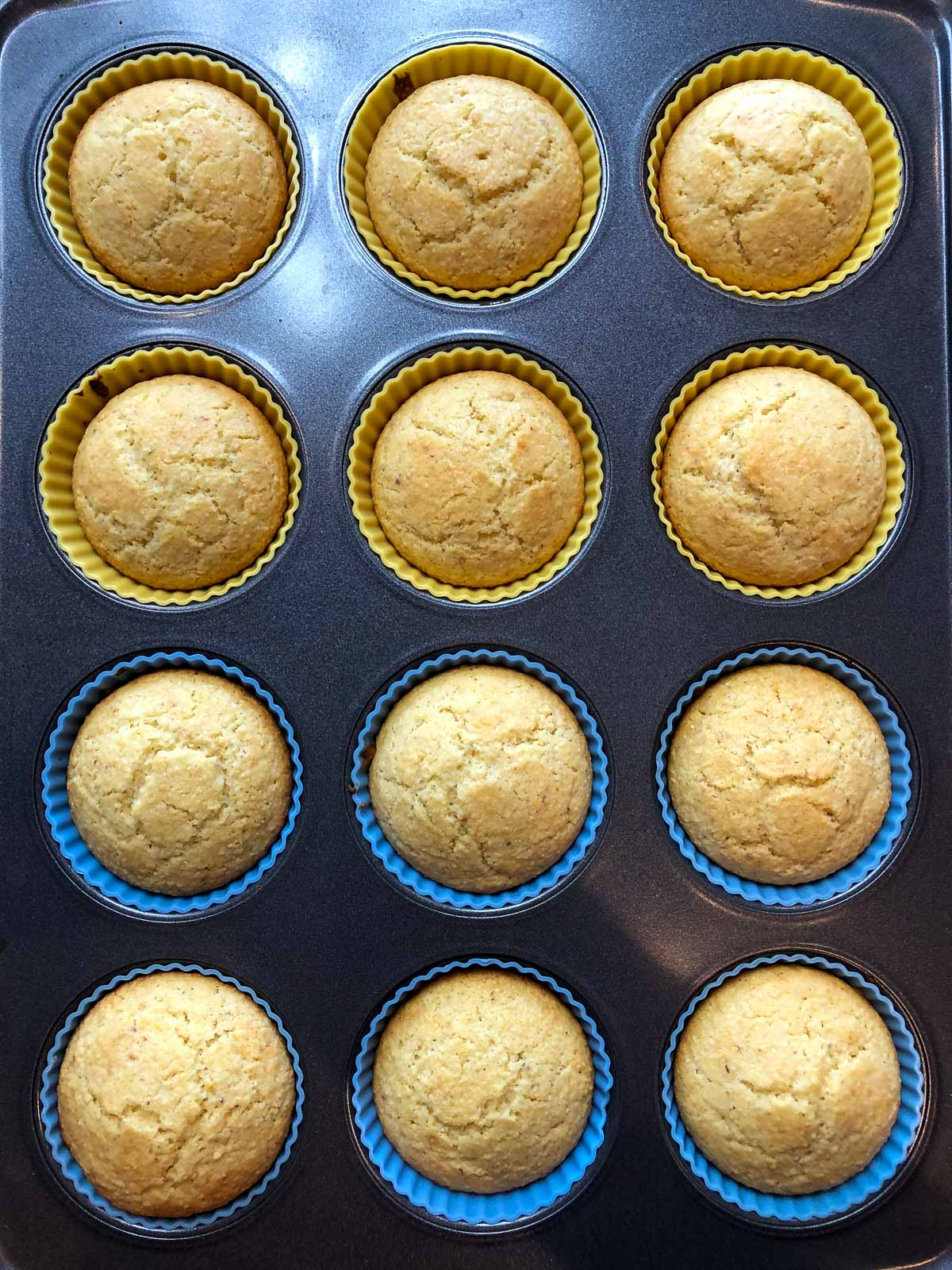 baked cornbread muffins in silicone baking cups and muffin pan
