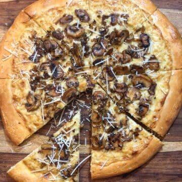 sliced mushroom leek tart with Dijon cream sauce and parmesan cheese