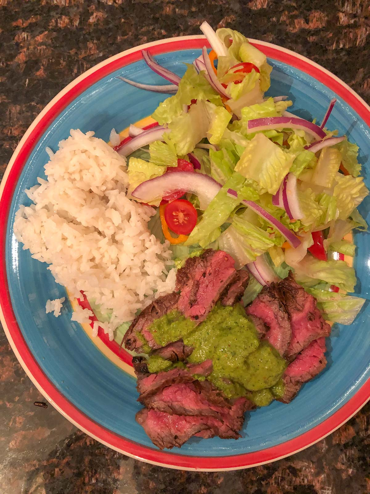 flank steak with chimichurri sauce, coconut rice, and salad
