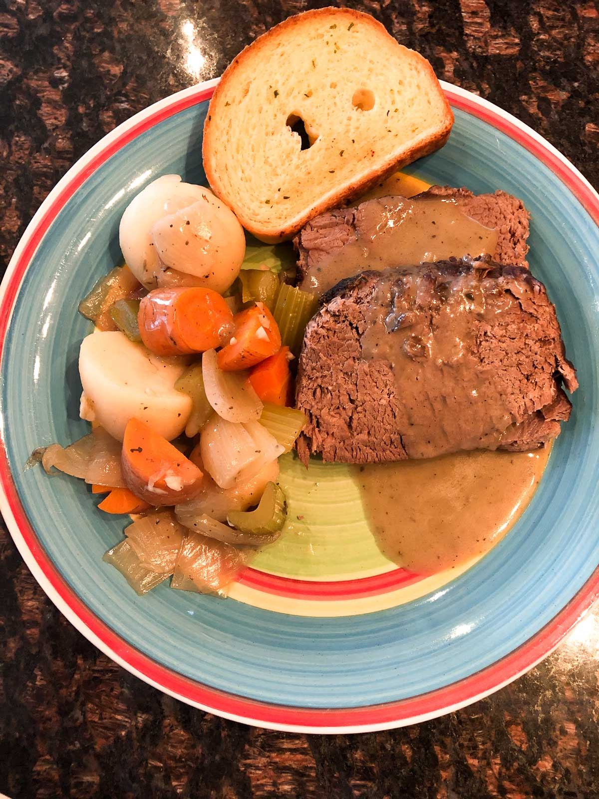 slow cooked pot roast with root vegetables and garlic bread