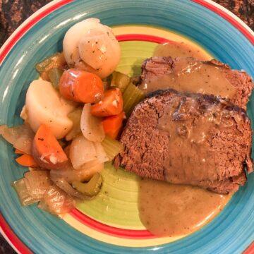 Sliced roast dinner with vegetables and gravy